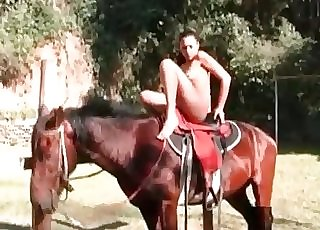Slim woman takes off her clothes and shows off her body for a horse